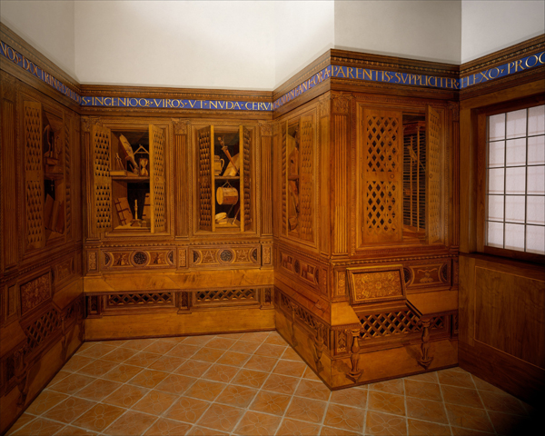 Designed by Federigo da Montefeltro, executed in the workshop of Giuliano da Maiano<br />Studiolo from the Ducal Palace in Gubbio, c. 1478–82<br />Walnut, beech, rosewood, oak, and fruitwoods in walnut base, 485 x 518 x 384 cm (190 15/16 x 203 15/16 x 151 3/16 in.)<br />Installed at The Metropolitan Museum of Art, New York<br />Image © The Metropolitan Museum of Art, New York, NY